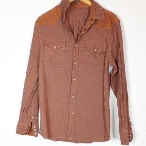 Cowboy style rust color plaid shirt.